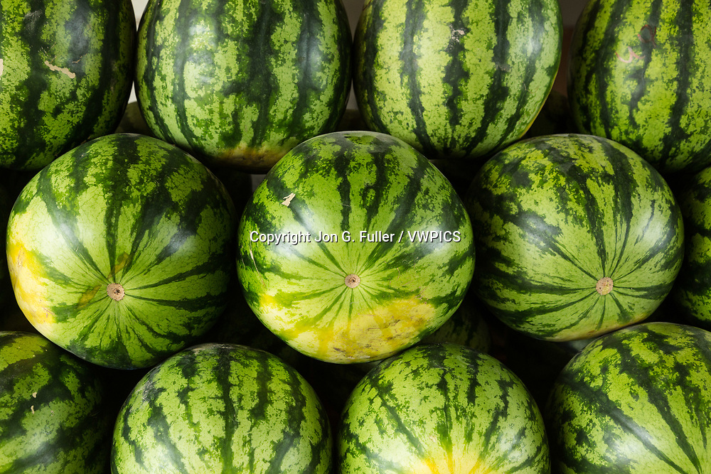 Watermelons for sale at a market stand in Paramaribo, Suriname.