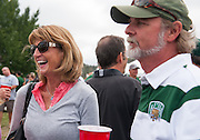 Laurle Kennedy, Ohio University Alumni, interacts with old classmates at the Homecoming 2013 Tailgate event. Photo by Elizabeth Held