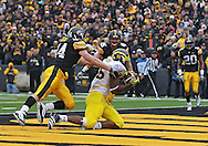 November 05, 2011: Michigan Wolverines tight end Kevin Koger (86) pulls in a 7 yard touchdown pass as Iowa Hawkeyes linebacker James Morris (44) defends during the second half of the NCAA football game between the Michigan Wolverines and the Iowa Hawkeyes at Kinnick Stadium in Iowa City, Iowa on Saturday, November 5, 2011. Iowa defeated Michigan 24-16.