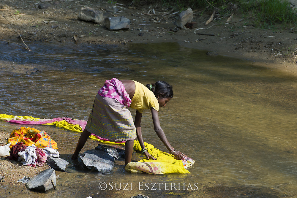 Woman washing clothes in river<br /> Village near Kaziranga National Park<br /> Assam, India<br /> *No model release available - for editorial use only