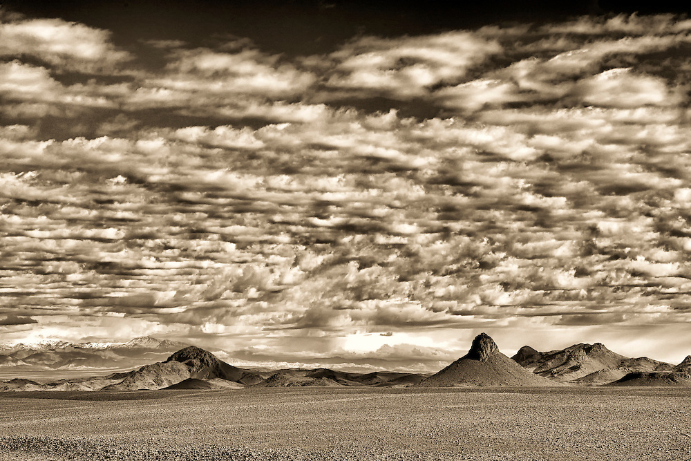Volcanic mountains with cloudy sky, Morocco.