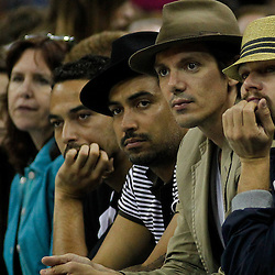April 9, 2012; New Orleans, LA, USA; Actor Leonardo DiCaprio (right) watches courtside during the second half of a game between the New Orleans Hornets and the Los Angeles Lakers at the New Orleans Arena. The Lakers defeated the Hornets 93-91. Mandatory Credit: Derick E. Hingle-US PRESSWIRE