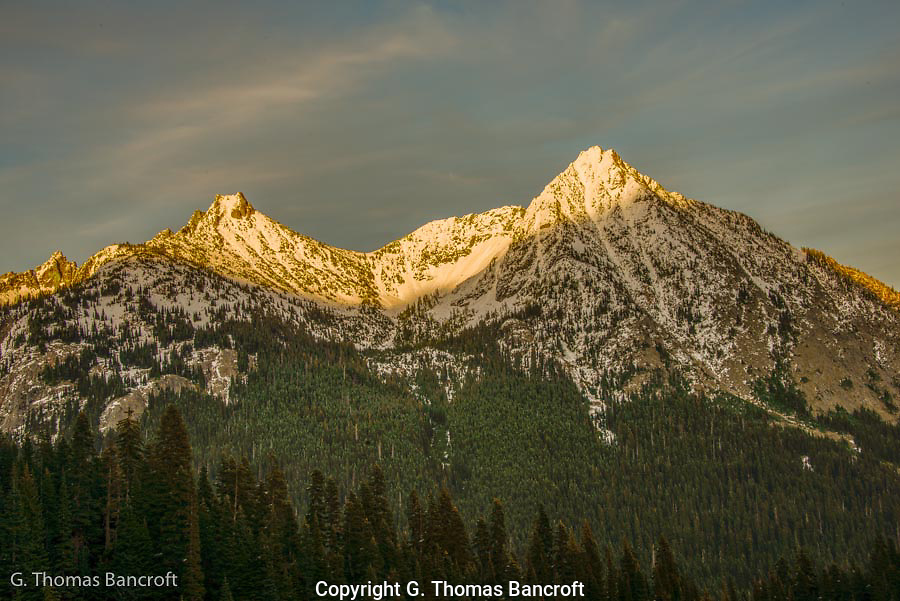 Cutthroat Peak (left) and Whistler Mountain (right) glow in the evening light.  The Pacific Crest Trail climbs around the left side of Cutthroat Peak