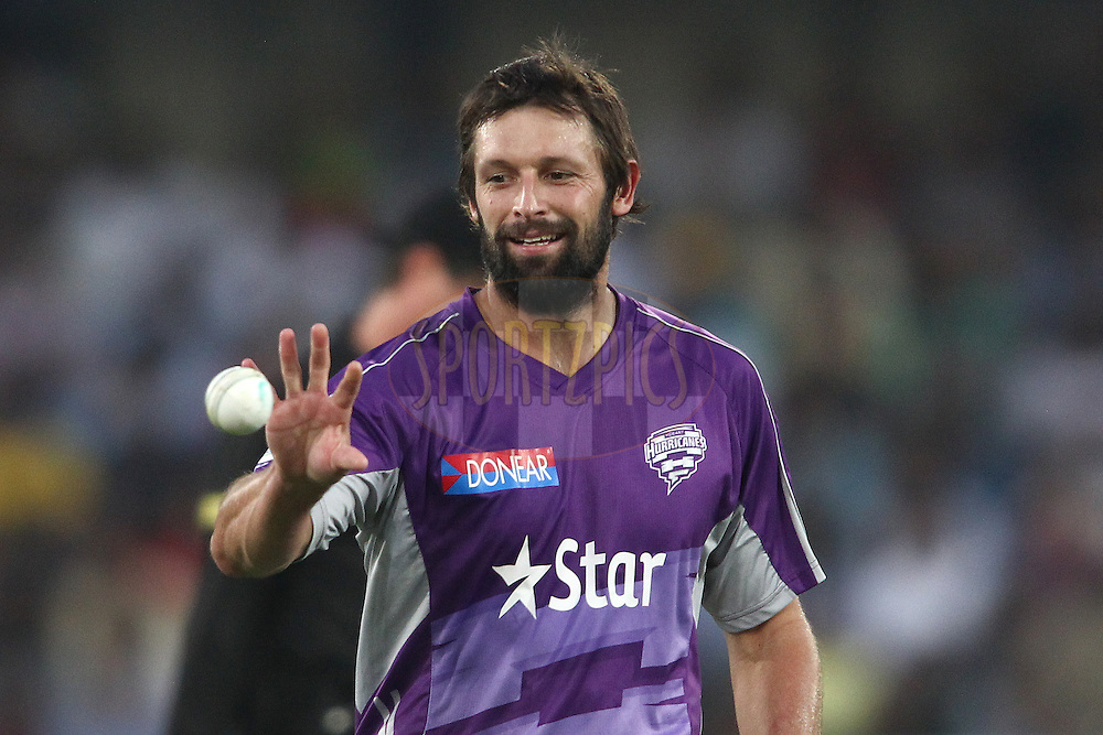 Ben Hilfenhaus of the Hobart Hurricanes during the first semi final match of the Oppo Champions League Twenty20 between the Kolkata Knight Riders and the Hobart Hurricanes held at the Rajiv Gandhi Cricket Stadium, Hyderabad, India on the 2nd October 2014<br /> <br /> Photo by:  Shaun Roy / Sportzpics/ CLT20<br /> <br /> <br /> Image use is subject to the terms and conditions as laid out by the BCCI/ CLT20.  The terms and conditions can be downloaded here:<br /> <br /> http://sportzpics.photoshelter.com/gallery/CLT20-Image-Terms-and-Conditions-2014/G0000IfNJn535VPU/C0000QhhKadWcjYs