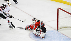 Mar 17, 2009; Newark, NJ, USA; New Jersey Devils goalie Martin Brodeur (30) makes a save on Chicago Blackhawks center Dave Bolland (36) during the first period at the Prudential Center.