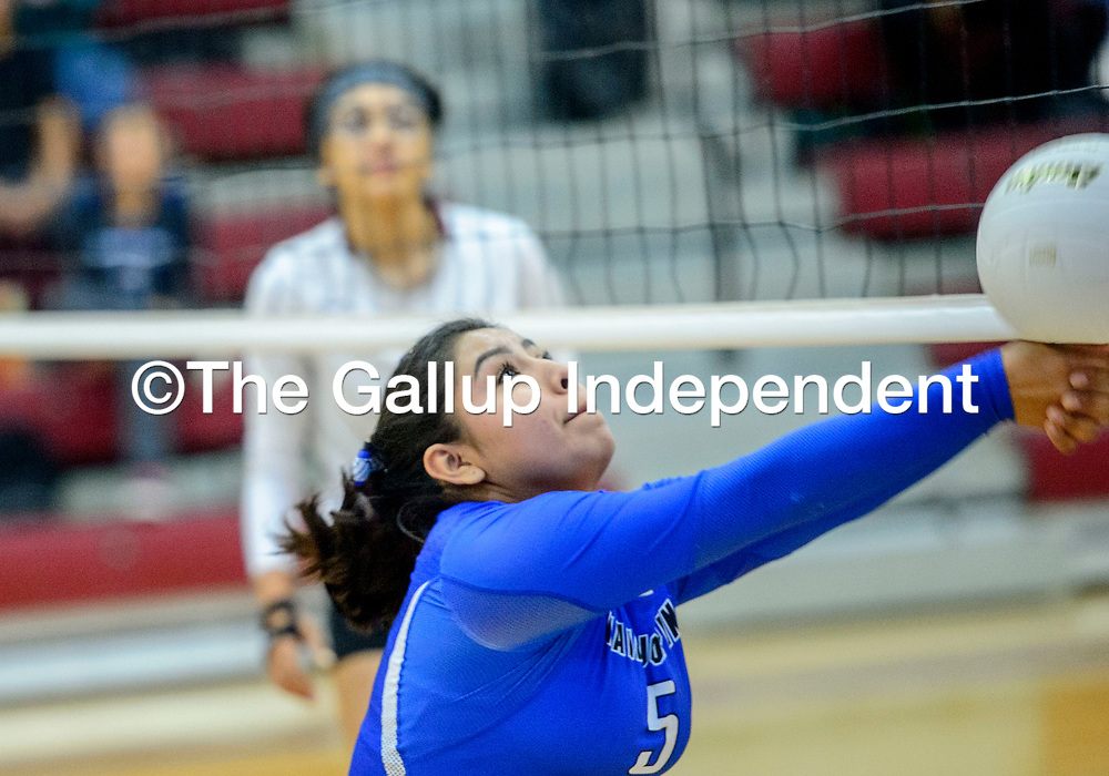 Navajo Pine Warrior Ahedabah June (5) reaches to volley to the Ramah Mustangs at Ramah High School Thursday.