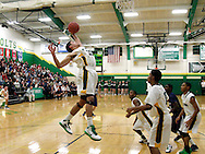 Northmont senior Mike Howard (30) at the basket as the Fairmont Firebirds play the Northmont Thunderbolts at Northmont High School in Clayton, Friday, December 16, 2011.