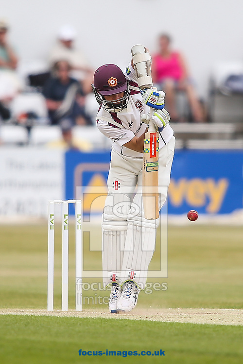 Stephen Peters of Northamptonshire gets up off of his toes to defend during the LV County Championship Div Two match at the County Ground, Northampton<br /> Picture by Andy Kearns/Focus Images Ltd 0781 864 4264<br /> 08/06/2015