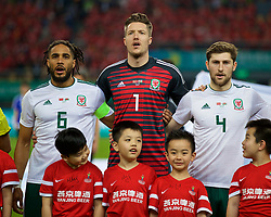 NANNING, CHINA - Thursday, March 22, 2018: Wales' captain Ashley Williams, goalkeeper Wayne Hennessey and Ben Davies sing the national anthem before opening match of the 2018 Gree China Cup International Football Championship between China and Wales at the Guangxi Sports Centre. (Pic by David Rawcliffe/Propaganda)