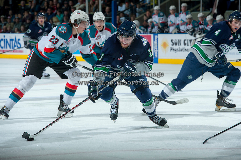 KELOWNA, CANADA - APRIL 5: Branden Troock #11 of the Seattle Thunderbirds skates with the puck at the Kelowna Rockets on April 5, 2014 during Game 2 of the second round of WHL Playoffs at Prospera Place in Kelowna, British Columbia, Canada.   (Photo by Marissa Baecker/Getty Images)  *** Local Caption *** Branden Troock;