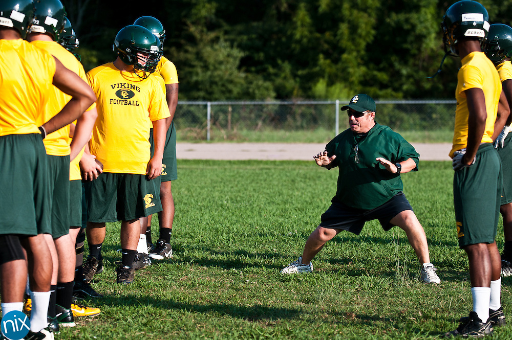 First year Central Cabarrus head coach Donnie Kiefer works with his players at football practice Monday July 30 at Central Cabarrus High School. (photo by James Nix)