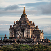 BAGAN, Myanmar (Burma) - Built in the 12th century, Thatbyinnyu Temple is one of the more prominent temples in the Bagan Archeological Zone. It stands adjacent to the famous Ananda Temple. Bagan was the ancient capital of the Kingdom of Pagan. During its height, from the 9th to the 13th century, over 10,000 Buddhist temples and pagodas were built. Several thousand of them survive today.