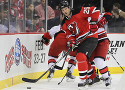 Feb 16; Newark, NJ, USA; New Jersey Devils center Jason Arnott (25) skates with the puck during the first period at the Prudential Center.