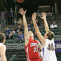 Colt forward Zach Biggs (33) battles for the rebound against Viking forward Eric Siebenshuh (40)