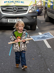 © Licensed to London News Pictures. 14/02/2020. London, UK. A young marcher with a banner as students outside the Home Office. Students climate change strikers demonstrate on the streets of Westminster to protest against the Governments's lack of action on the climate crisis. Photo credit: Alex Lentati/LNP