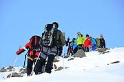Climbing groups ascending and decending Cima del Similaun in the Otztal Alps in Austria.