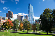 People strolling in Boston Common by the Public Garden city park and skyscrapers in Boston, Massachusetts, USA