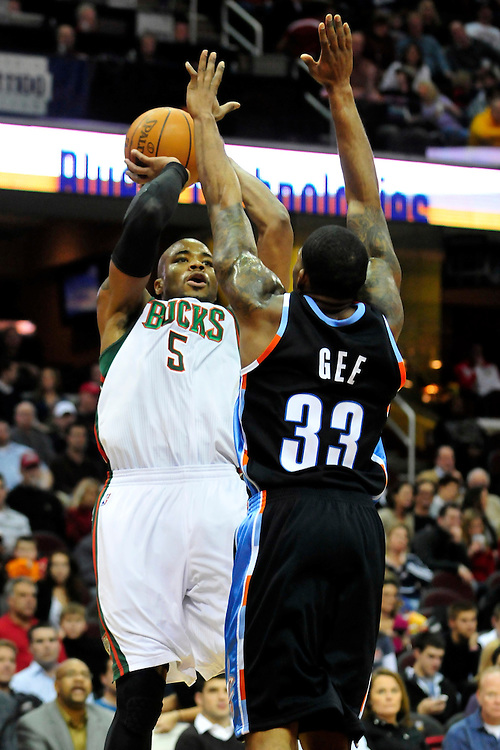 Jan. 21, 2011; Cleveland, OH, USA; Milwaukee Bucks small forward Corey Maggette (5) shoots over Cleveland Cavaliers shooting guard Alonzo Gee (33) during the third quarter at Quicken Loans Arena. The Bucks beat the Cavaliers 102-88. Mandatory Credit: Jason Miller-US PRESSWIRE