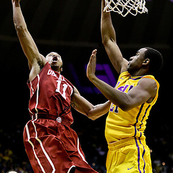 Jan 30, 2016; Baton Rouge, LA, USA; Oklahoma Sooners guard Isaiah Cousins (11) shoots over LSU Tigers forward Aaron Epps (21) during the second half of a game at the Pete Maravich Assembly Center. Oklahoma defeated LSU 77-75. Mandatory Credit: Derick E. Hingle-USA TODAY Sports
