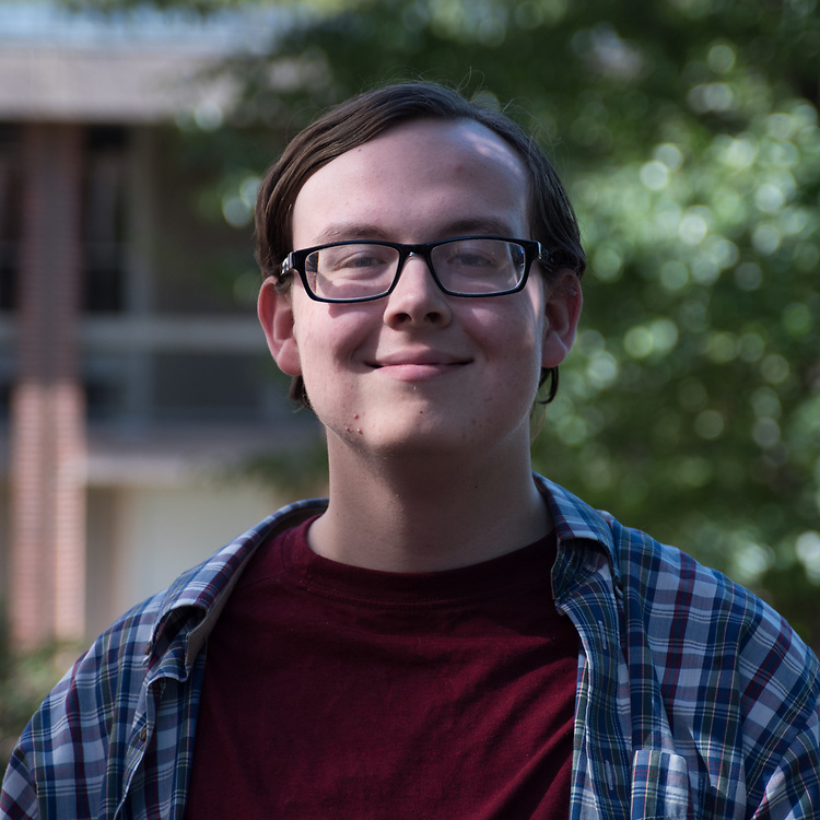 Daily writer Ryan Eggers poses for a portrait on September 23. ( Seohyun Shim / The Tufts Daily )