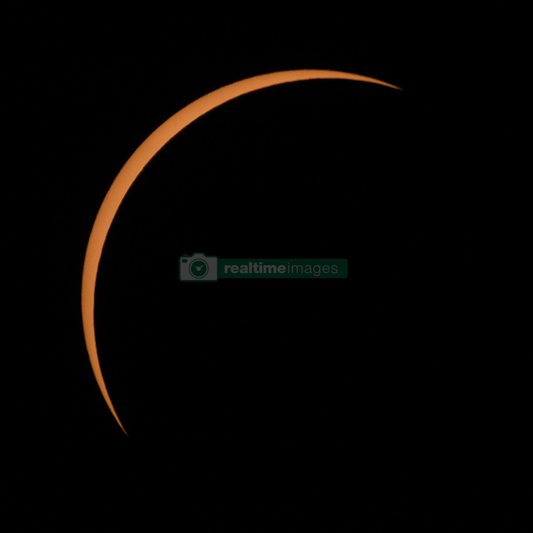 The Moon is seen passing in front of the Sun at the point of the maximum of the partial solar eclipse near Banner, Wyoming on Monday, Aug. 21, 2017. A total solar eclipse swept across a narrow portion of the contiguous United States from Lincoln Beach, Oregon to Charleston, South Carolina. A partial solar eclipse was visible across the entire North American continent along with parts of South America, Africa, and Europe.  Photo Credit: (NASA/Joel Kowsky)
