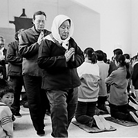 LIUJIAZHUANG VILLAGE, 8 APRIL 2001:members of the congregation come back from the holy communion on Palm Sunday in an official church. China cut relations with the Vatican in the early fifites and since then, established a Patriotic catholic Church that's controlled by Chinese authorities.<br />Catholics who refused to give up their ties with the Vatican, started worshipping in underground churches and consequently were persecuted for a long time. Since the late nineties though, relations with the Vatican informally started to improve. Although China still has no diplomatic relations, many representatives from official churches met the pope John Paull II secretely . The Vatican, under the pope's leadership, has made several efforts to recover the tie with China. In February 2006 , Hong Kong Bishop Joseph Zen was named one of the first 15 new cardinals, which is seen by many as a gesture of goodwill and a significant step towards recovering the Vatican-China relationship.
