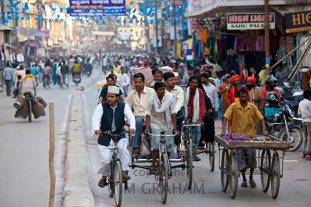 Muslim and Hindus in crowded street scene during holy Festival of Shivaratri in city of Varanasi, Benares, Northern India