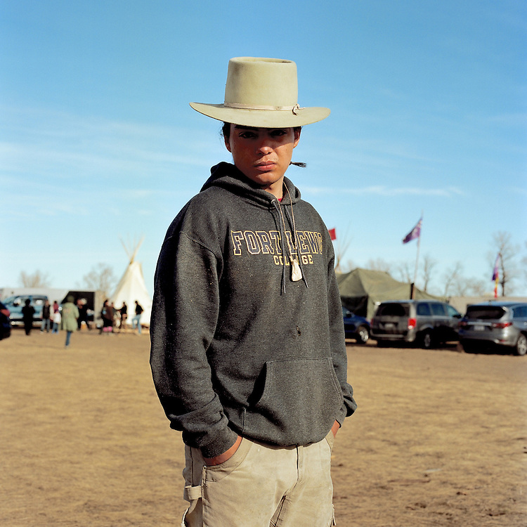 OCETI SAKOWIN CAMP, CANNON BALL, NORTH DAKOTA - NOVEMBER 25, 2016: Arrin Paul previously of Big Lake, Alaska, who now resides in Oklahoma, is a student of Fort Lewis College and came to Standing Rock over his holiday weekend to protest the construction of the Dakota Access Pipeline.