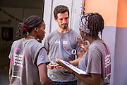 Bertha Mhepela, Joe Radcliffe and Francisca Mlingwa preparing for the VSO ICS Community Action Day CAD held for local members of the community in Y2K Hall Lindi, Lindi region. Tanzania.