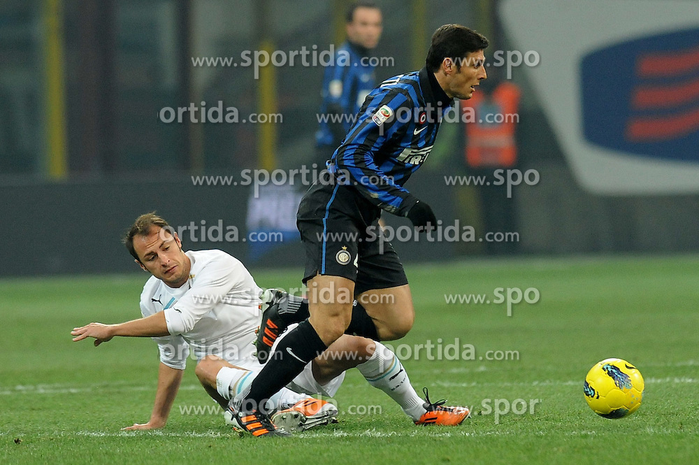 22.01.2012, Stadion Giuseppe Meazza, Mailand, ITA, Serie A, Inter Mailand vs Lazio Rom, 19. Spieltag, im Bild Javier ZANETTI (Inter), Stefan RADU (Lazio), the football match of Italian 'Serie A' league, 19th round, between Inter Mailand and Lazio Rom at Stadium Giuseppe Meazza, Milan, Italy on 2012/01/22. EXPA Pictures © 2012, PhotoCredit: EXPA/ Insidefoto/ Alessandro Sabattini..***** ATTENTION - for AUT, SLO, CRO, SRB, SUI and SWE only *****