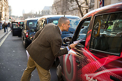 © Licensed to London News Pictures. 10/02/2016. London, UK. MP CLIVE LEWIS attends a London black cab protest in Westminster, London against Government interference in the taxi industry and 'active support' for Uber, which they allege is a 'tax avoiding global corporation' Photo credit: Ben Cawthra/LNP