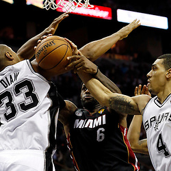 Jun 13, 2013; San Antonio, TX, USA; Miami Heat small forward LeBron James (6) rebounds against San Antonio Spurs shooting guard Danny Green (4) and center Boris Diaw (33) during the third quarter of game four of the 2013 NBA Finals at the AT&T Center. Mandatory Credit: Derick E. Hingle-USA TODAY Sports