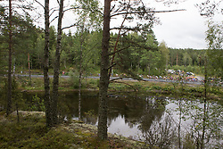 The peloton rides past a small pond in the early part of Stage 1 of the Ladies Tour of Norway - a 101.5 km road race, between Halden and Mysen on August 18, 2017, in Ostfold, Norway. (Photo by Balint Hamvas/Velofocus.com)