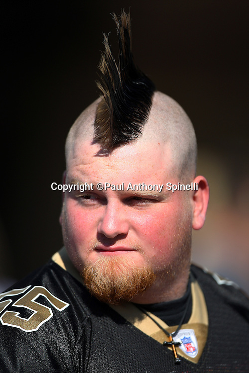 NEW ORLEANS - DECEMBER 07: A New Orleans Saints fan sports a mohawk haircut outside the stadium before the game against the Atlanta Falcons at the Louisiana Superdome on December 7, 2008 in New Orleans, Louisiana. The Saints defeated the Falcons 29-25. ©Paul Anthony Spinelli