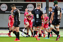 Tom Rogers of Scarlets celebrates scoring a try with team mates Guinness PRO14, Rodney Parade, Newport, UK 29/08/2020<br /> Dragons vs Scarlets<br /> <br /> Mandatory Credit ©INPHO/Dougie Allward