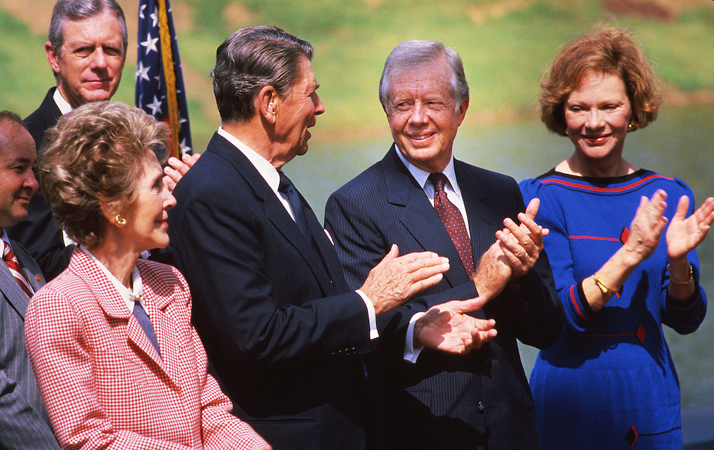 Presidents Jimmy Carter and Ronald Reagan and their wives - Nancy Reagan and Rosalynn Carter at the dedication of the Carter Presidential Library in Atlanta, Georgia on October 1, 1986. - To license this image, click on the shopping cart below -