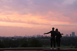 Primrose Hill, London, August 25th 2016. After a hot, sticky night, dawn, viewed from Primrose Hill, breaks across London. &copy;Paul Davey<br /> FOR LICENCING CONTACT: Paul Davey +44 (0) 7966 016 296 paul@pauldaveycreative.co.uk