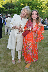 ANNABEL ELLIOT and AYESHA SHAND at the Quintessentially Foundation and Elephant Family 's 'Travels to My Elephant' Royal Rickshaw Auction presented by Selfridges and hosted by HRH The Prince of Wales and The Duchess of Cornwall held at Lancaster House, Cleveland Row, St.James's, London on 30th June 2015.