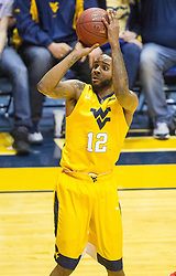 Feb 18, 2017; Morgantown, WV, USA; West Virginia Mountaineers guard Tarik Phillip (12) shoots a jump shot during the first half against the Texas Tech Red Raiders at WVU Coliseum. Mandatory Credit: Ben Queen-USA TODAY Sports