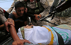 August 17, 2017 - Rafah, Gaza Strip, Palestinian Territory - A comrade mourns over the body of a Palestinian security man before it is carried during his funeral, in Rafah, southern Gaza Strip.  (Credit Image: © Ashraf Amra/APA Images via ZUMA Wire)