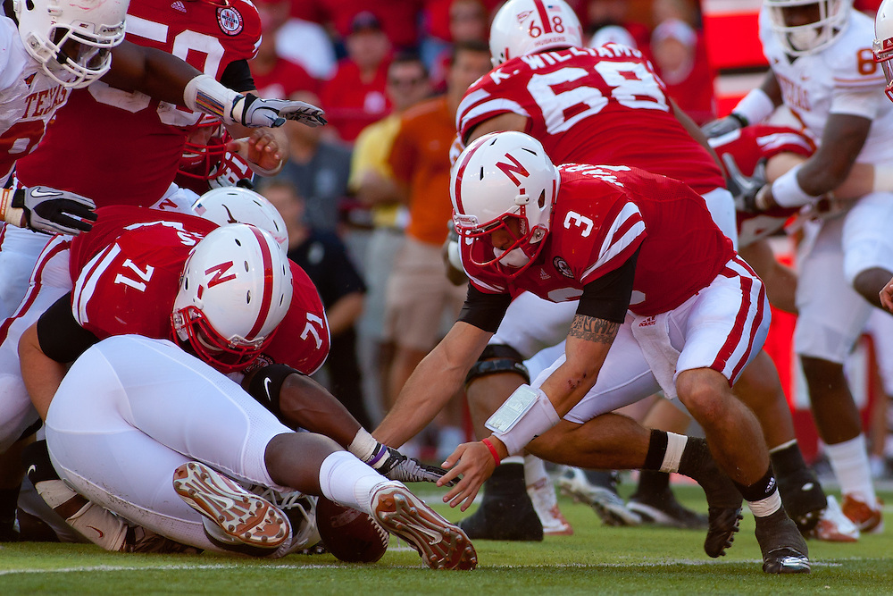 October 16, 2010: Nebraska Cornhuskers quarterback Taylor Martinez #3 recovers a fumble in the game against Texas Longhorns at Memorial Stadium in Lincoln, Nebraska. Texas defeated Nebraska 20 to 13.