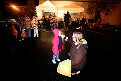 Kristi Schmidt, right, gives her daughter Reagan, 3, a sip of hot chocolate while listening to the University of Louisville Community Band. Husband and father Chris plays in the band and directs the band at Fairdale High School. (By Jonathan Palmer, Special to The Courier-Journal) December 6, 2008