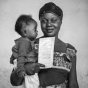 Mothers who brought their children in for check-ups and vaccinations hold their children and vaccination cards at the Mother and Child Health Center at the Bumbu District  Health Center, outside the capital city of Kinshasa. <br /> <br /> &quot;The DRC has made enormous progress over the last ten years regarding vaccine coverage,&quot; says Dr. Audry Mulumba, director of the country's Expanded Programme on Immunisation. &quot;In the 1990's only 30% of children had received diphtheria-pertussis-tetanus vaccine, but now our data shows some regions are close to 90%.&quot;<br /> <br /> As the DRC seeks to reach all children with immunization, maintaining the cold chain has proven to be a challenge. With GAVI's support DRC is gradually  modernizing its cold chain with 60 solar powered refrigerators, and 120 more soon to be delivered.
