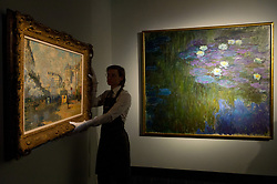 © Licensed to London News Pictures. 20/02/2018. London, UK. A painting titled Exterior de la Gare Saint-Lazare, effect de soleil by artist Claude Monet (L) and a painting titled Nympheas en flour by artist Claude Monet are on show as part of the collection of Peggy and David Rockefeller at the Christies art sale. Photo credit: Ray Tang/LNP