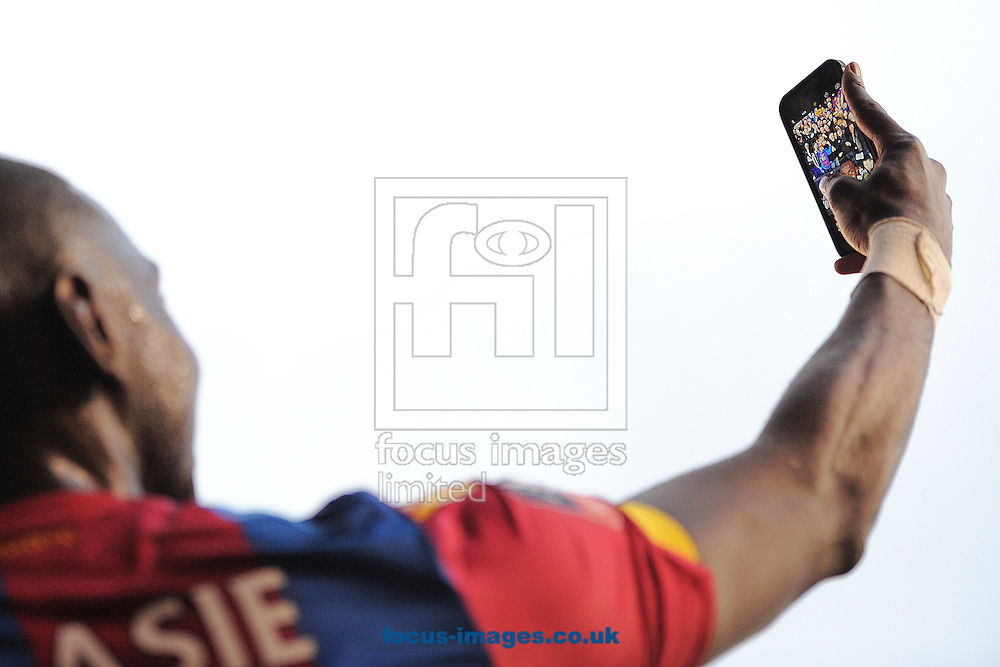 Yannick Bolasie of Crystal Palace takes a selfie with the Crystal Palace fans at the final whistle during the FA Cup match between Tottenham Hotspur and Crystal Palace at White Hart Lane, London<br /> Picture by Richard Blaxall/Focus Images Ltd +44 7853 364624<br /> 21/02/2016