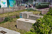 In the UK, 32,313 people have now died after testing positive for coronavirus which is now the highest death toll in Europe, even exceeding that of Italy. As the UK lockdown continues with social distancing measures still in effect, a construction landscape of concrete blocks with utopian illustrations of happy, aspirational families at the new development of Elephant Park at Elephant & castle, on 5th May 2020, in London, England.