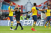 Referee Jon Moss talks to Arsenal's Alexis Sánchez during the The FA Cup match between Arsenal and Aston Villa at Wembley Stadium, London, England on 30 May 2015. Photo by Phil Duncan.