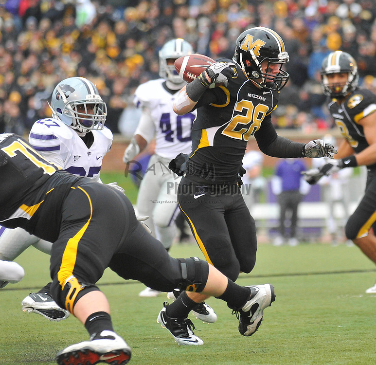 Nov 13, 2010; Columbia, MO, USA; Missouri Tigers wide receiver T.J. Moe (28) loses the ball on a run in the second half against the Kansas State Wildcats at Memorial Stadium. Missouri won 38-28. Mandatory Credit: Denny Medley-US PRESSWIRE