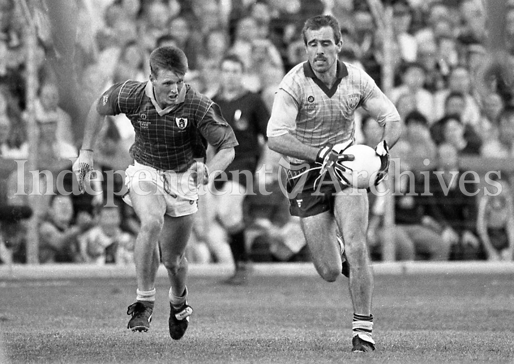 790-630<br /> Leinster Football Final at Croke Park, Dublin v Meath, 29th July 1990:<br /> Action on the pitch. David Foran (Dublin) breaks away from Colm Brady (Meath).<br /> Meath 1-14 Dublin 0-14<br /> Pic: Dara Mac Donaill, 29/7/90<br /> (Part of the Independent Newspapers Ireland/NLI Collection)