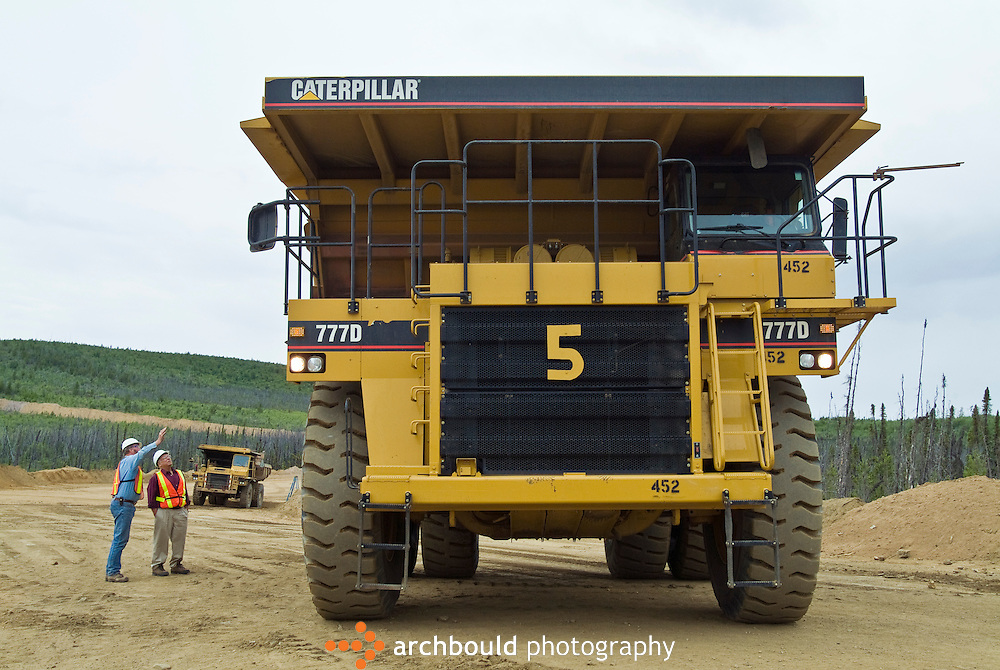 Mine workers are dwarfed by a mining truck in Yukon, Canada.<br /> <br /> NOT IN YOUR BUDGET? Contact Cathie for a price specific to your project.